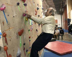 Michael Cohen climbing at age 89.