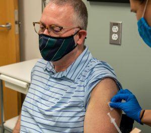Man receives vaccine